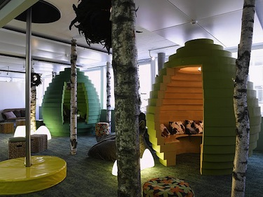 an office with trees, pods to sit in and a bat-pole