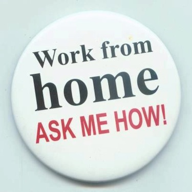 a wearable button reading 'work from home - ask me how'
